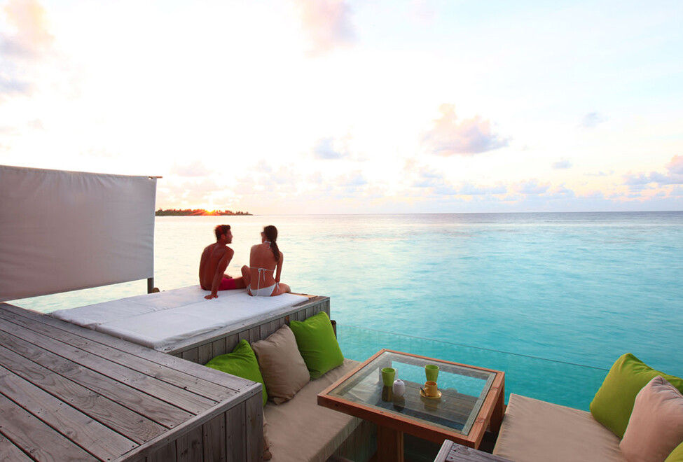 water villa deck sunset six senses laamu