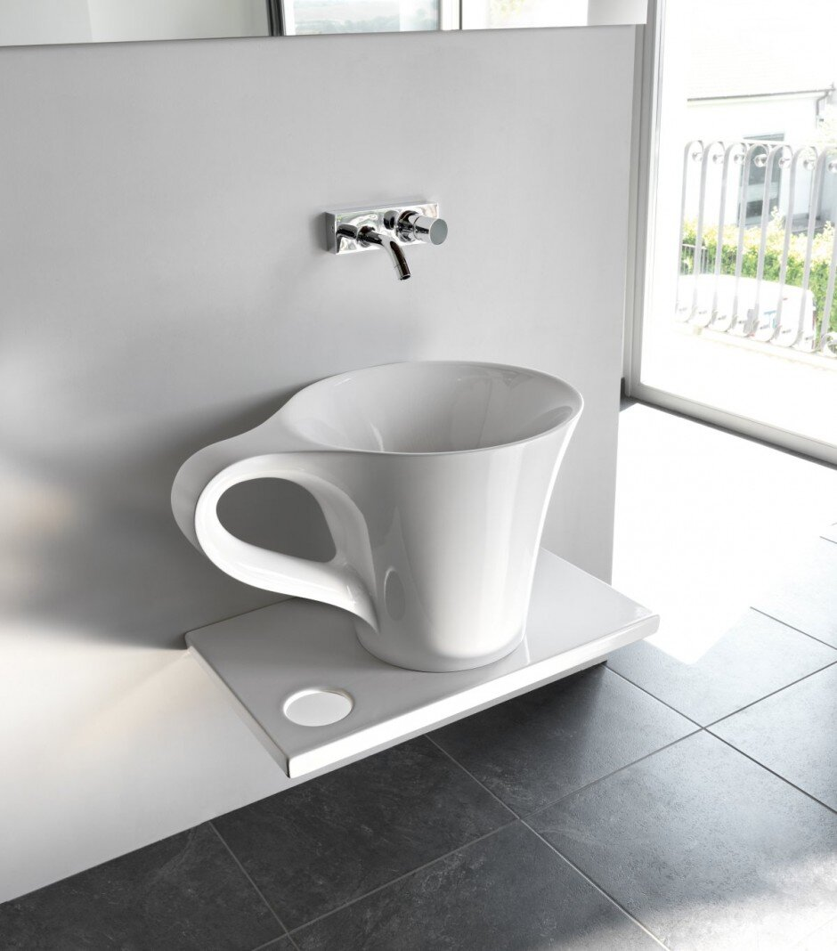 a cup of coffee in the bathroom by meneghello paolelli. Black Bedroom Furniture Sets. Home Design Ideas