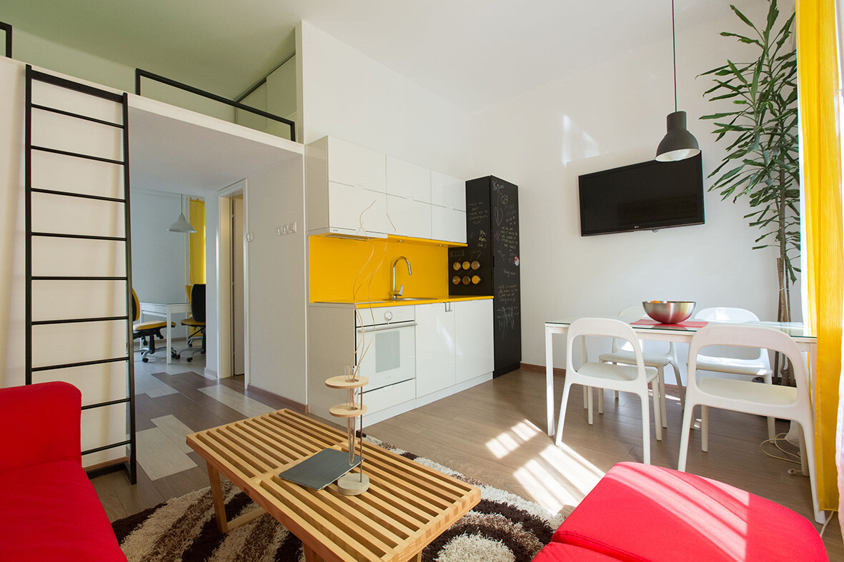 Studio apartment modified to perform two functions: office and home