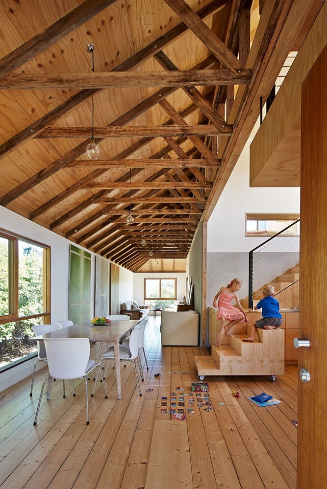 Old space converted into a family beach home by Andrew Simpson Architects and Charles Anderson