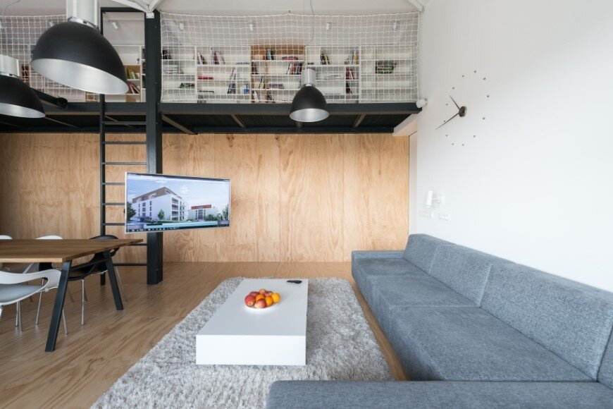 Industrial style in harmony with warm natural materials in a cozy loft by Rules Architects - Bratislava (2)