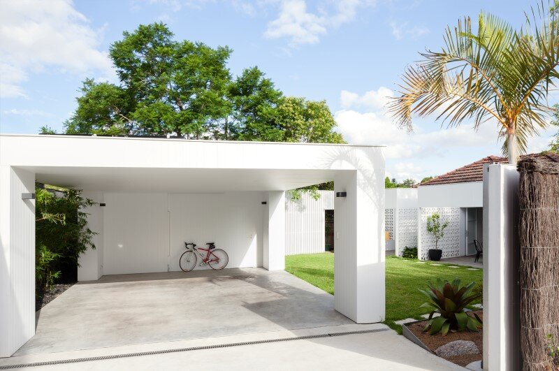 Breeze block house was reorganized to create a more for Contemporary carport design architecture