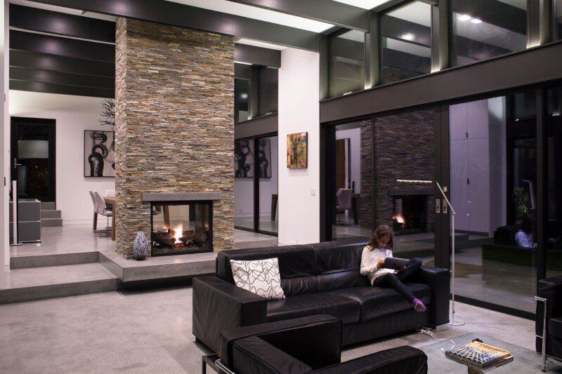 Modern Atrium House – energy efficient new home by Klopf Architecture