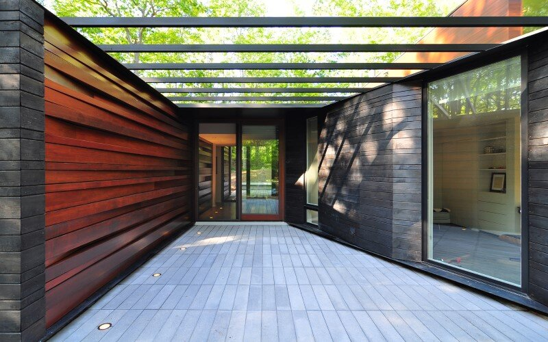 Sylvan Retreat textured wood structure with a green roof (10)