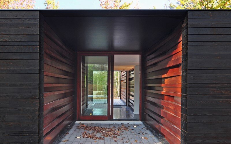 Sylvan Retreat textured wood structure with a green roof (11)