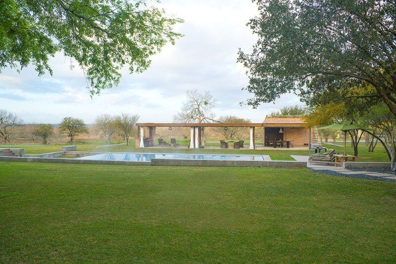 Temple Ranch Pool House with jacal shade structures (16)