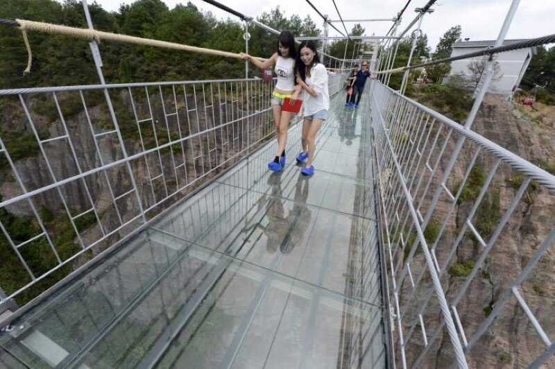 High-altitude glass-bottomed bridge (made of glass) opens in Hunan, China (9)