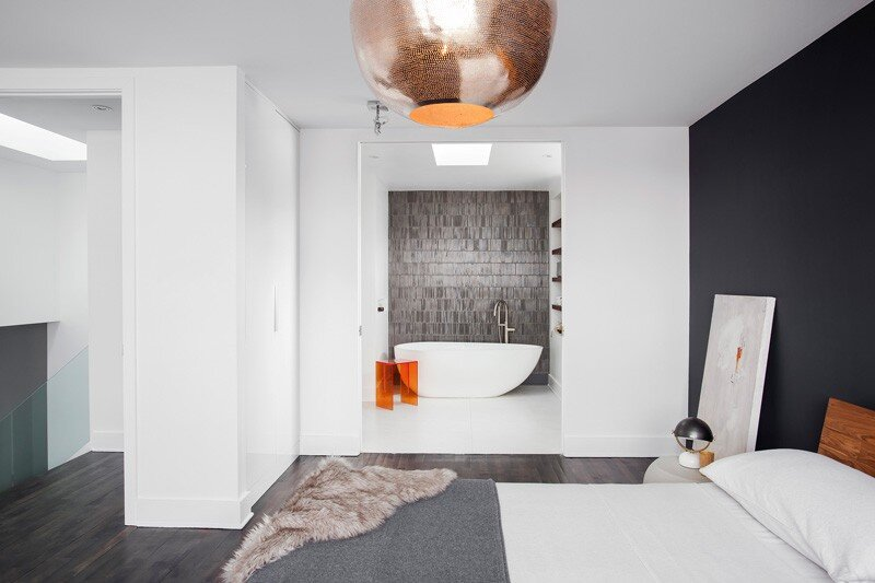 Interiors designed in a smoked grey palette with warm walnut accents and soft white walls (13)