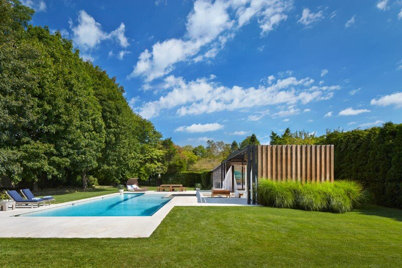 Lavish pool and spa retreat with a stunning wood and steel structure (1)