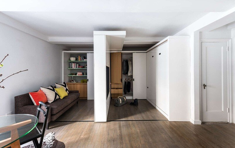 This apartment uses a mechanized moving wall to form different areas (3)