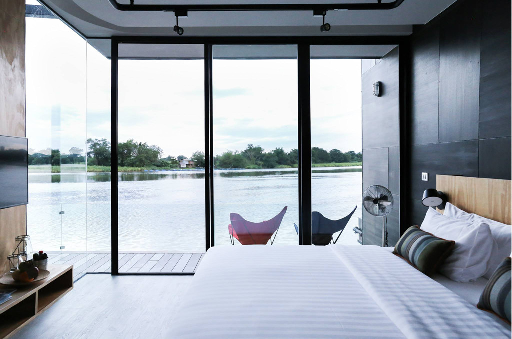 Agaligo Studio have designed - X-Float - a series of floating homes on the River Kwai Bridge, Thailand (12)