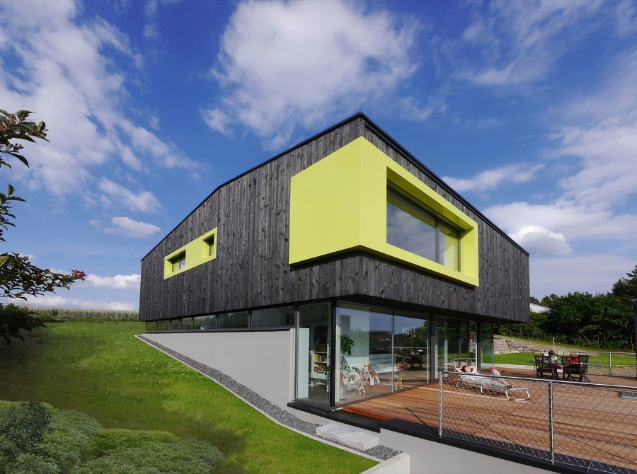This German Family House is a Black Cuboid Supported by Glass Walls (16)