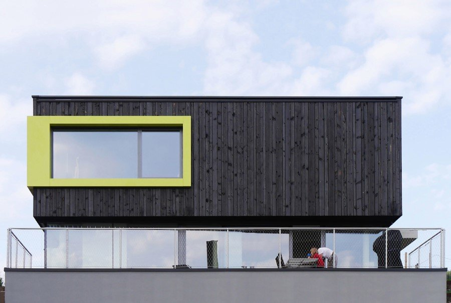 This German Family House is a Black Cuboid Supported by Glass Walls (3)