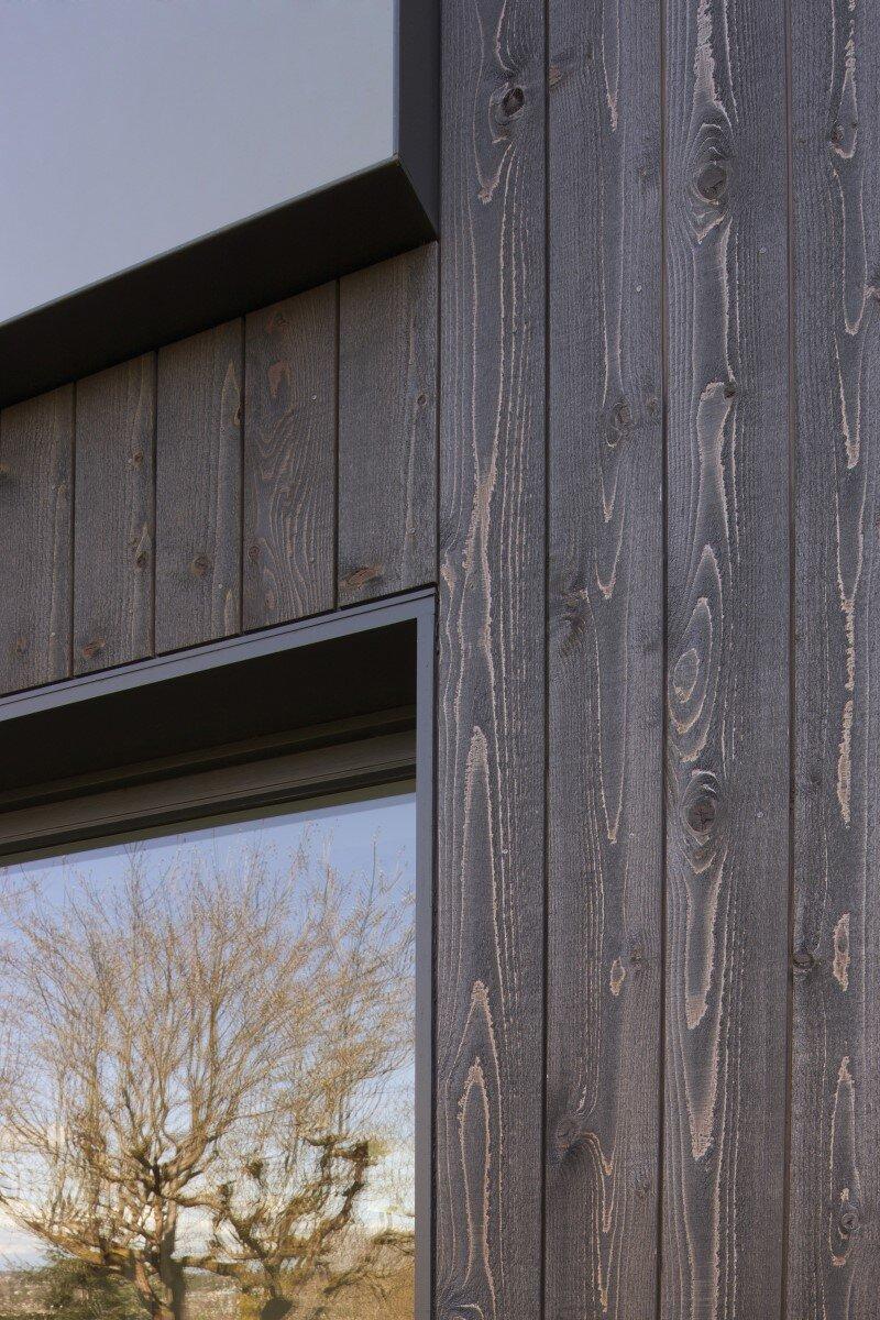 Janus residence 1930 brick tudor transformed in a house for Tudor siding panels