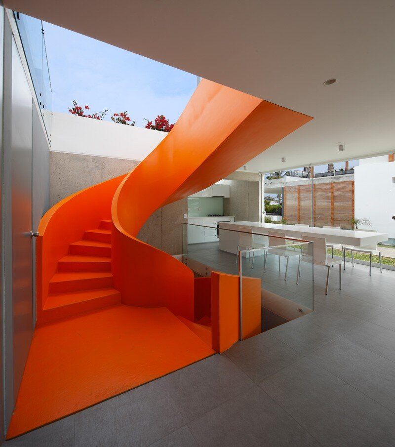 Casa Blanca Has a Striking Orange Staircase That Connects All Indoor Areas (23)