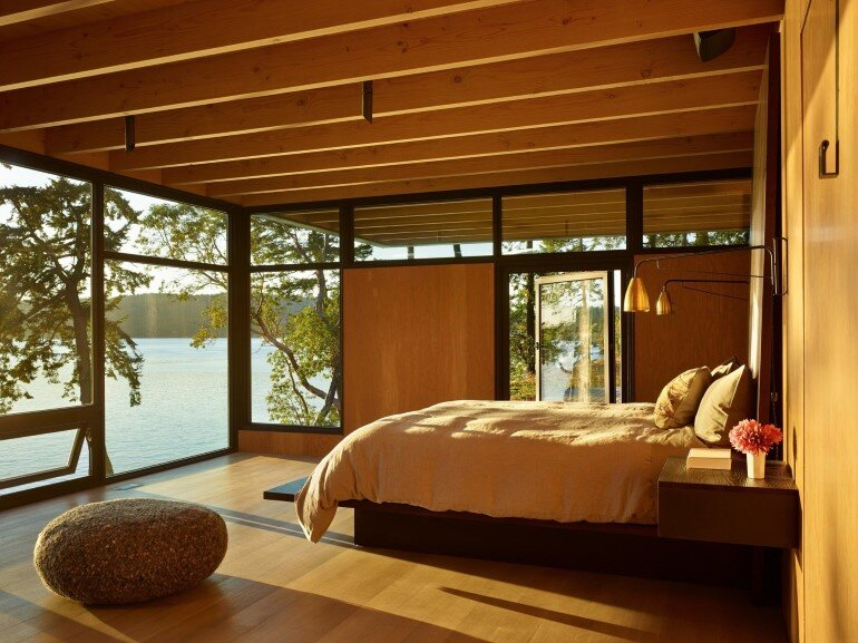 This Waterfront Retreat is Embraced by Dense Woods