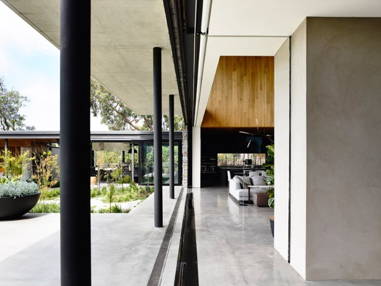 Concrete House Provide Strong Visual Connections Between Levels (9)