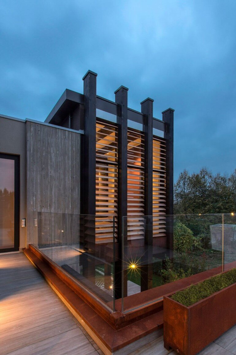 Modern Concrete Block House with Wooden Patio Attached (12)