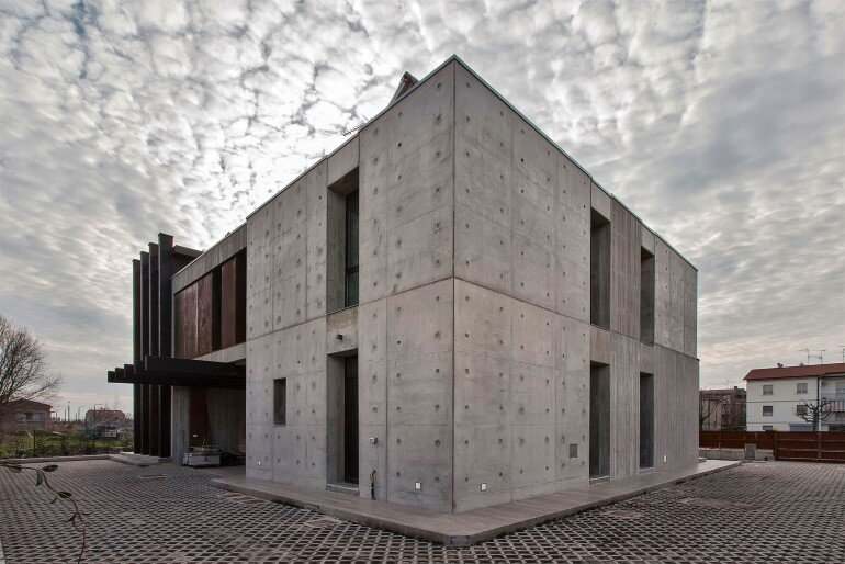 Modern concrete block house with wooden patio attached for Cement block homes