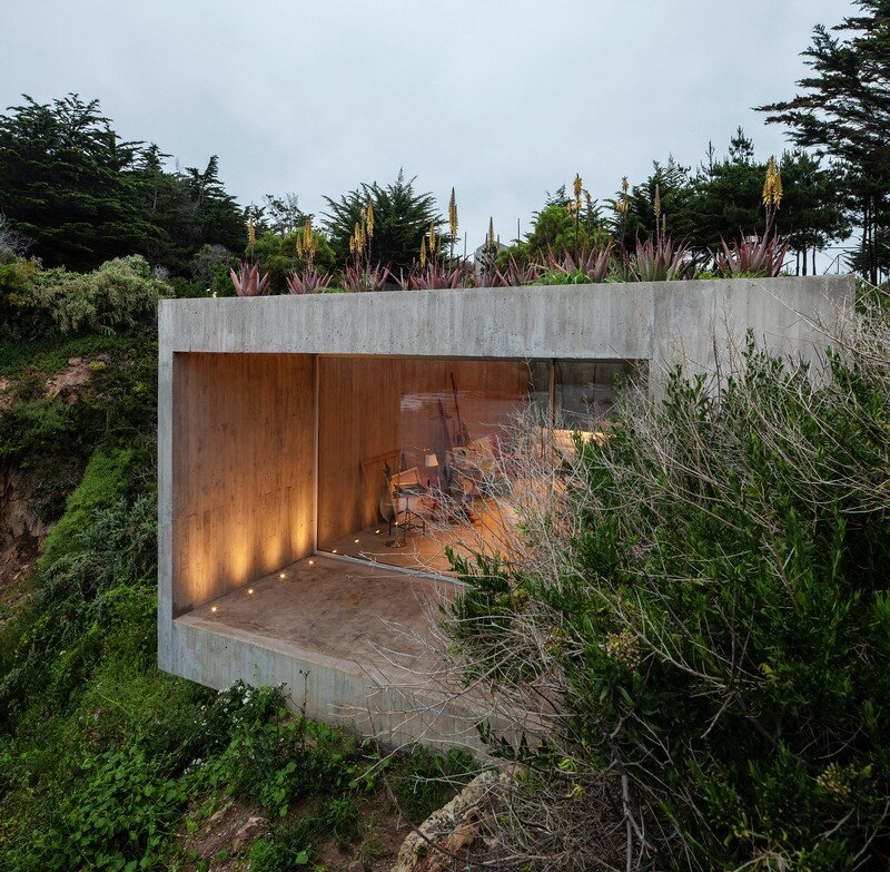 Concrete Painting Studio Built on a Rocky Hill