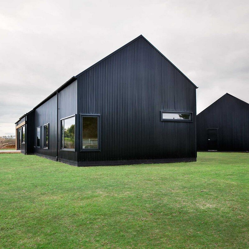 Modern barn form innovative black barn by red architecture for Barn architecture plans