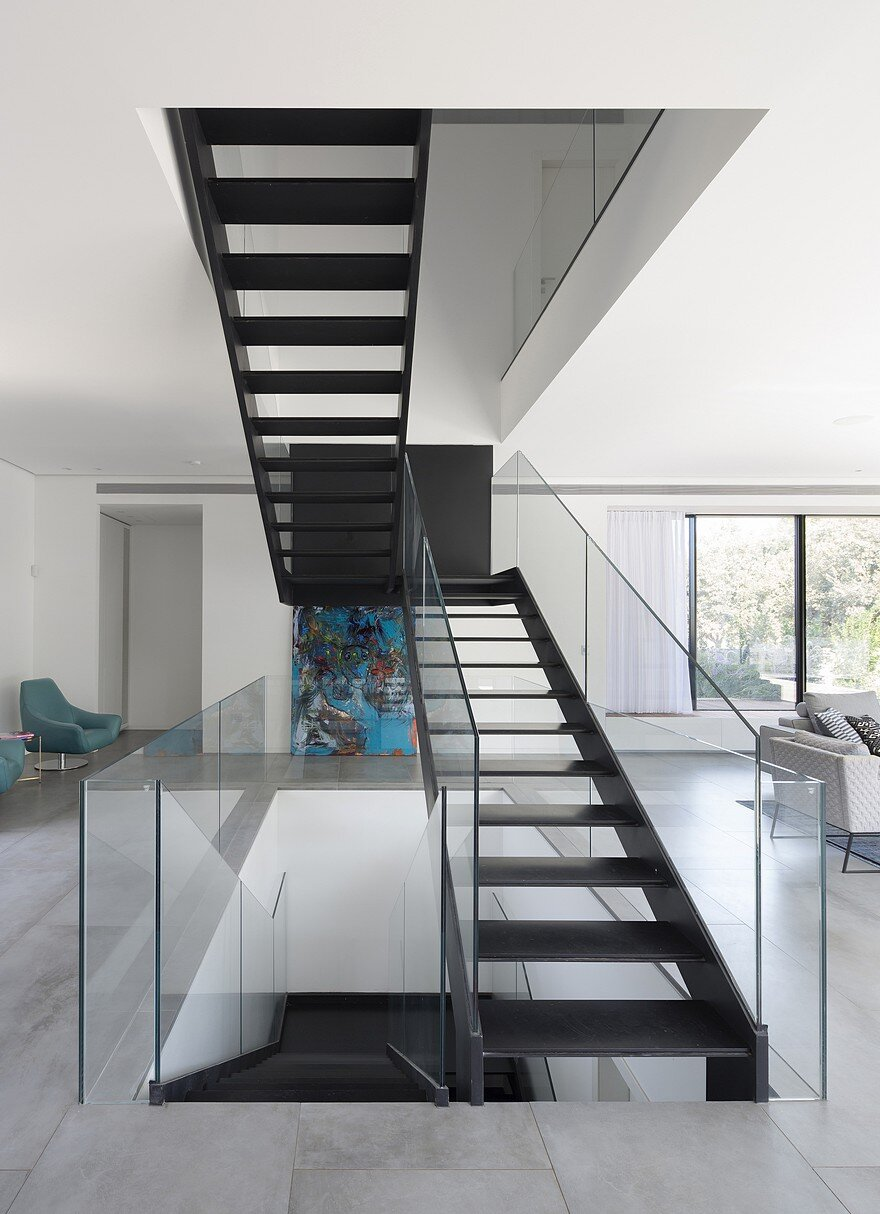L Shaped Home Organized Around A Central Steel Staircase