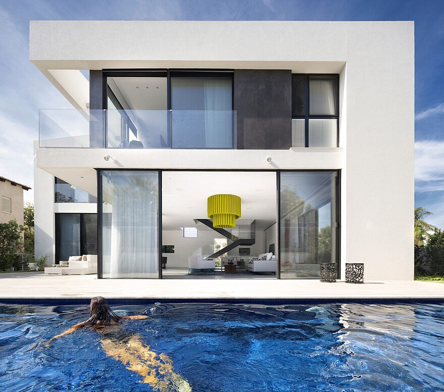 L Shaped Swimming Pool Layouts: L-Shaped Home Organized Around A Central Steel Staircase