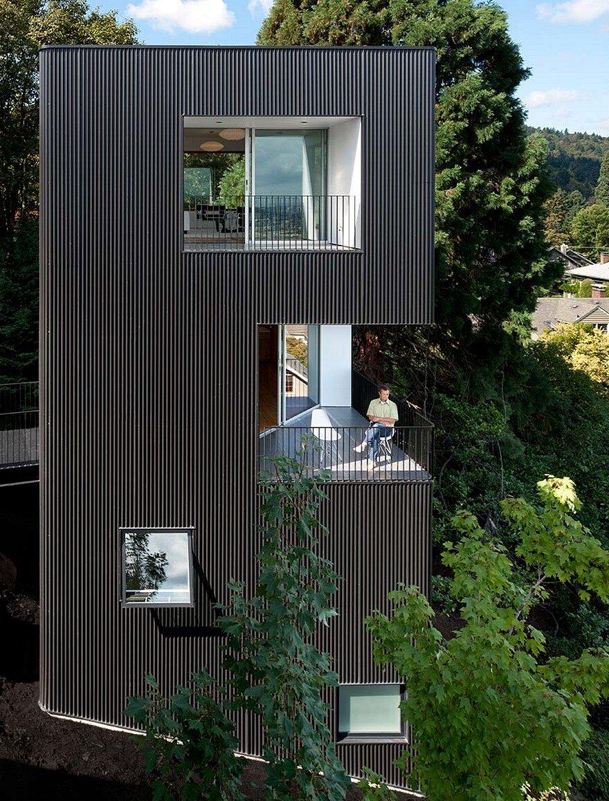 Modern Vertical House Accessed by a Steel Pedestrian Bridge