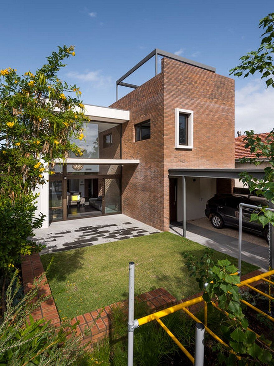 Impressive Brick Home With Open And Glazed Living Spaces