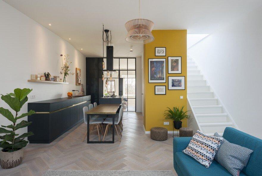 A former storage attic transformed into a modern apartment in amsterdam