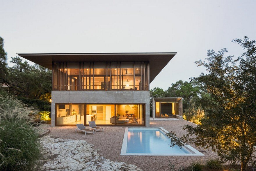 Balcones House is Like a Glass Pavilion Rising from a Solid Concrete Base