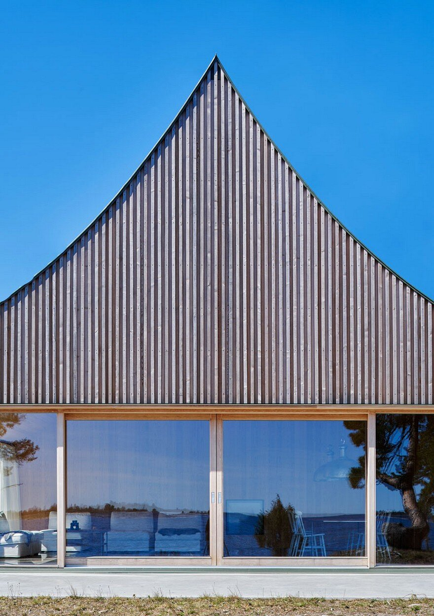 This scandinavian wooden house has a tent like roof over a for Tent over house