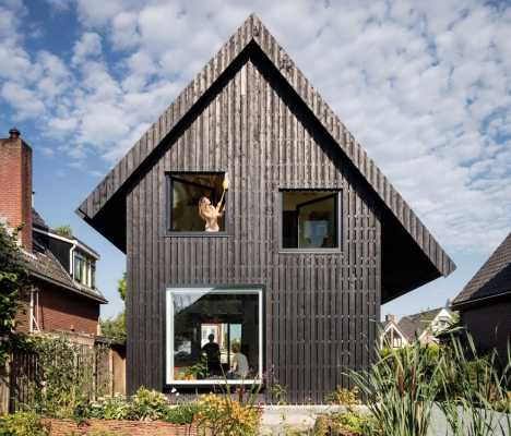 Old Brick House Replaced by a New Sustainable Timber House in Amsterdam