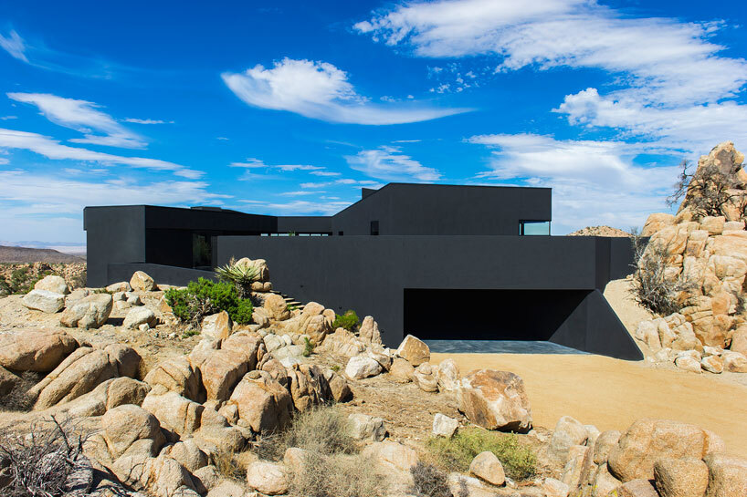 Black Desert House: Imposing Architecture and Dramatic Landscape