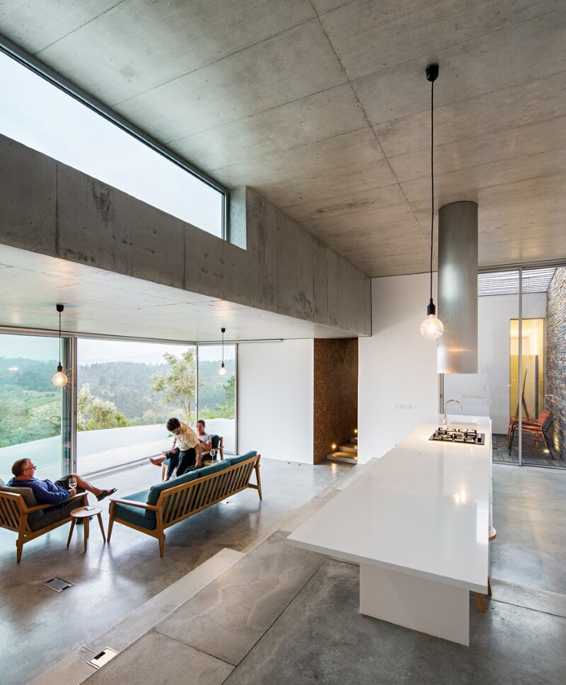 Gateira concrete house designed in harmony with dramatic landscape (1)