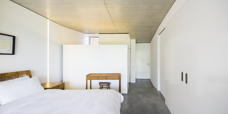 Gateira concrete house designed in harmony with dramatic landscape (14)