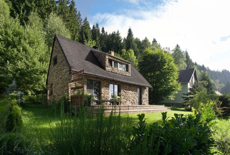 Old house converted into a summerhouse for a young couple