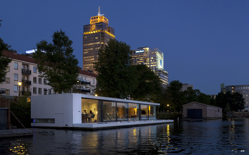 Watervilla Weesperzijde on the river Amstel in Amsterdam