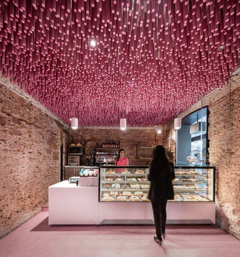 Pink Wooden Sticks Hanging From The Ceiling