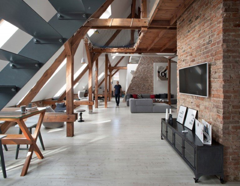 Attic Renovation in Poznan, Poland by Cuns Studio