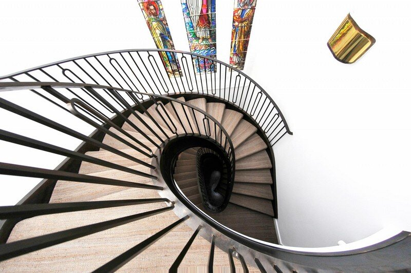 Cantilevered Helical Staircase with Gun Metal Finish