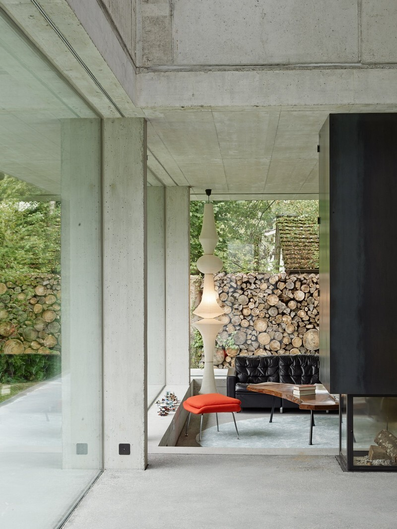 The Architecture of This Family House Combines Raw Concrete with Dark Wood (8)