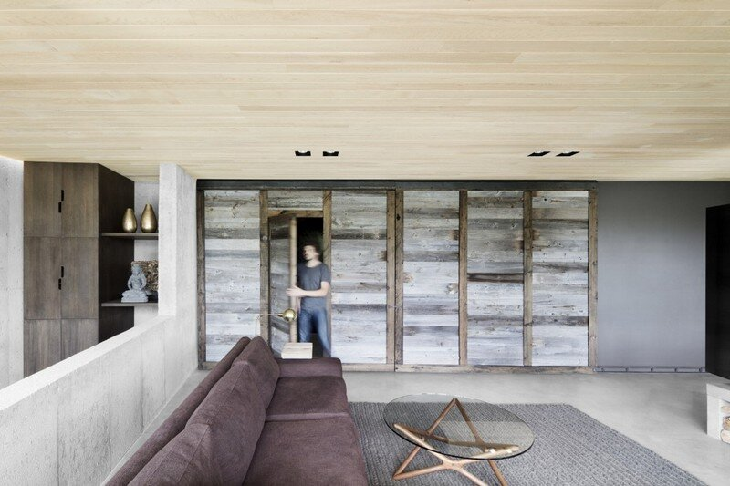 living room - Low Impact House Design by Alain Carle Architect (12)