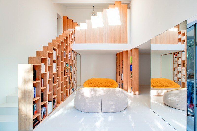 Bookshelf House is an Old House Converted into a Light-Filled Residence