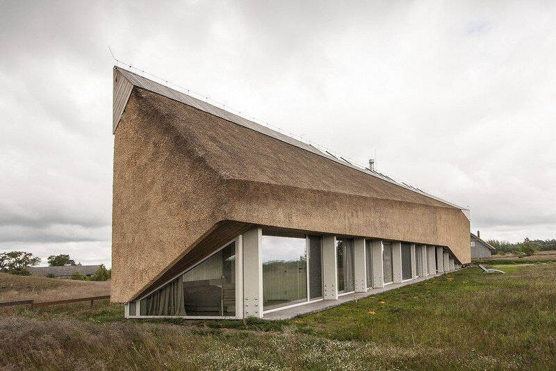 The Dune House is a Sharp Linear Structure with a Facade of Straw