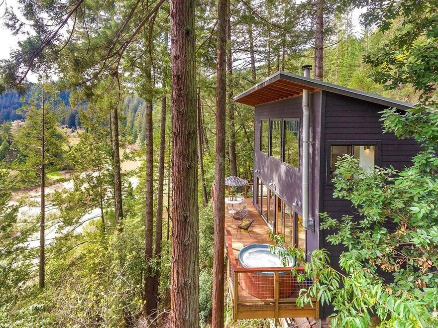 Russian River Cabin with Mid-Century Modern Design 16