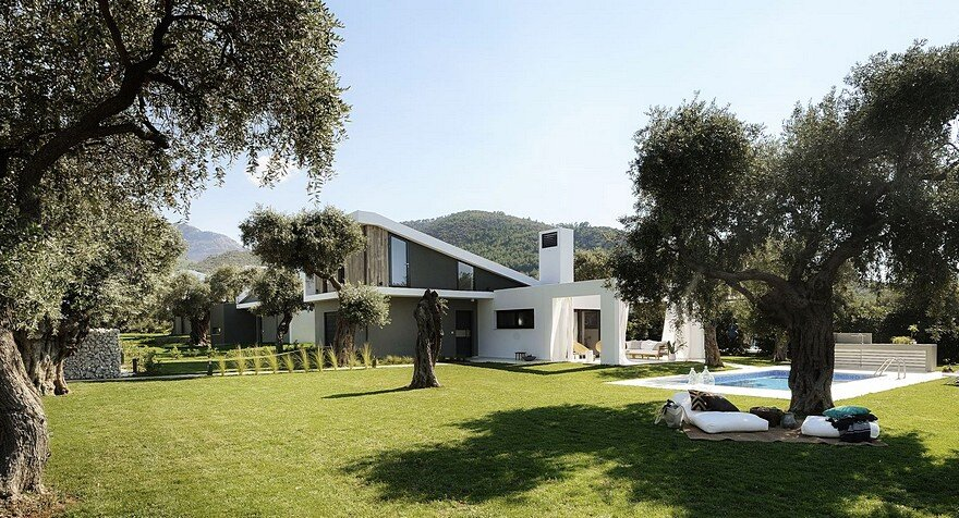 L-Shaped Villa Featuring Large Openings, Clean Surfaces and Bohemian Luxury 1