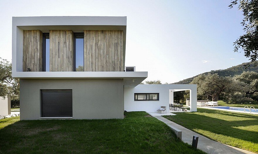 L-Shaped Villa Featuring Large Openings, Clean Surfaces and Bohemian Luxury 4