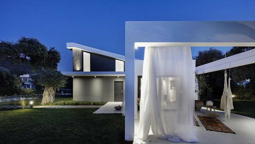 L-Shaped Villa Featuring Large Openings, Clean Surfaces and Bohemian Luxury 16