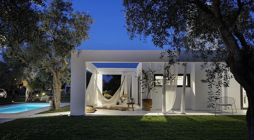 L-Shaped Villa Featuring Large Openings, Clean Surfaces and Bohemian Luxury 18